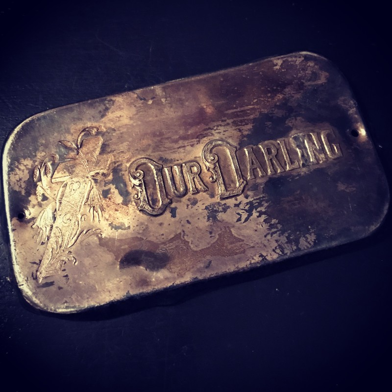 Our Darling coffin plaque at Alchemy and Ashes