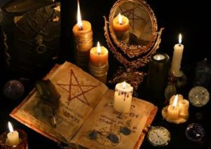 spell book and candles
